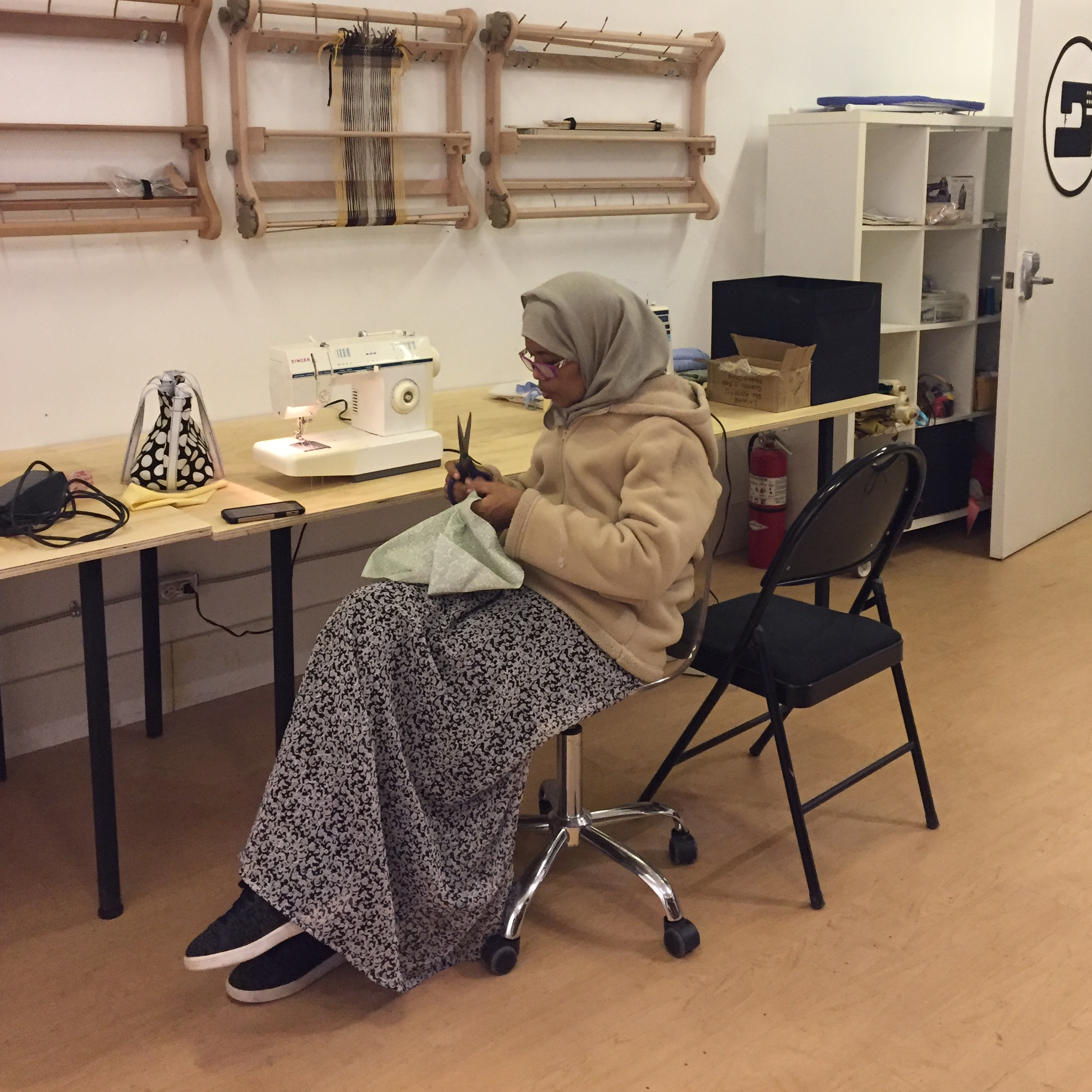 One of the participants sewing a Feast Bag